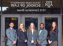 Students in fr上t of Texas A&M School of Law
